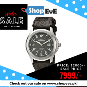 Adjustable brown 20mm nylon strap with black genuine leather trim fits up to 8-inch wrist circumference Charcoal gray dial with date window at 3 o'clock; full Arabic numerals